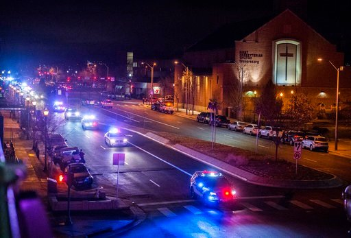 (Christian Murdock/The Gazette via AP). Public safety vehicles follow the hearse carrying the body of slain El Paso County Sheriff's Deputy Micah Flick, Monday, Feb. 5, 2018, in Colorado Springs, Colo. Flick was shot and killed while he and other offic...