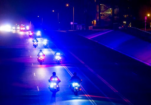 (Dougal Brownlie/The Gazette via AP). A police procession makes its way down South Nevada Avenue that was held for fallen El Paso County Sheriff's Deputy Micah Flick, Monday, Feb. 5, 2018, in Colorado Springs, Colo. Flick was shot and killed while he a...