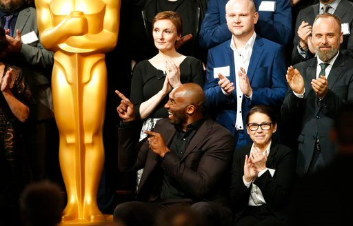 (Photo by Danny Moloshok/Invision/AP). Kobe Bryant, bottom row left, attends the 90th Academy Awards Nominees Luncheon at The Beverly Hilton hotel on Monday, Feb. 5, 2018, in Beverly Hills, Calif.