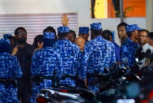 (AP Photo/Mohamed Sharuhaan). Policemen arrest former Maldives president and opposition leader Maumoon Abdul Gayoom, center, after the government declared a 15-day state of emergency in Male, Maldives, early Tuesday, Feb. 6, 2018. The Maldives governme...
