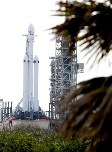 (AP Photo/John Raoux). A Falcon 9 SpaceX heavy rocket stands ready for launch on pad 39A at the Kennedy Space Center in Cape Canaveral, Fla., Monday, Feb. 5, 2018. The Falcon Heavy, scheduled to launch Tuesday afternoon, has three first-stage boosters,...