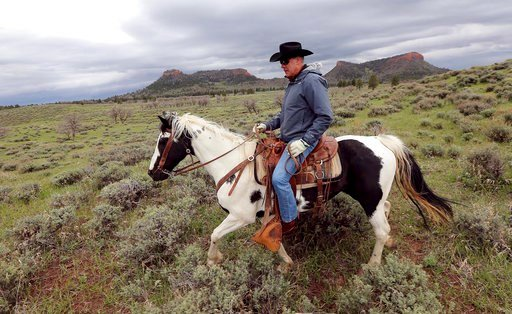 (Scott G Winterton/The Deseret News via AP, File). FILE - In this May 9, 2017, file photo, Interior Secretary Ryan Zinke rides a horse in the new Bears Ears National Monument near Blanding, Utah. Much of Bears Ears is on land administered by the Bureau...