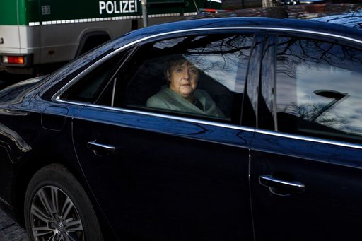 (Gregor Fischer/dpa via AP). German Chancellor Angela Merkel arrives at the headquarters of the Social Democratic party in Berlin, Monday, Feb. 5, 2018 prior to another day in the coalition talks on forming a new German government between Merkel's Chri...