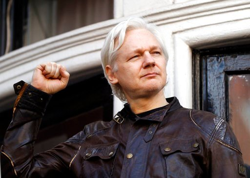 (AP Photo/Frank Augstein, FILE). FILE - In this May 19, 2017 file photo, WikiLeaks founder Julian Assange greets supporters outside the Ecuadorian embassy in London, where he has been in self imposed exile since 2012. A British judge is scheduled to ru...