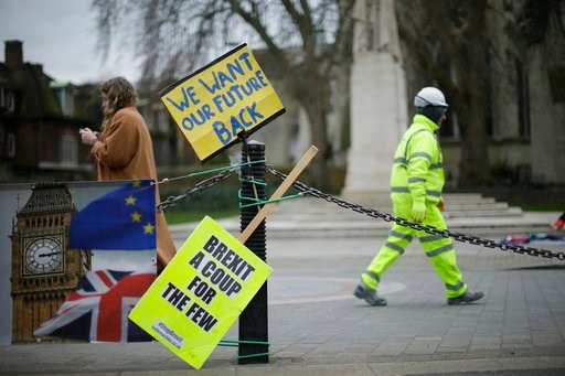 (AP Photo/Tim Ireland). Placards and banners opposing Brexit on railings as The European Commission's Chief Negotiator for the UK exiting the European Union, Michel Barnier is at 10 Downing Street for a meeting, outside the Houses of Parliament, London...