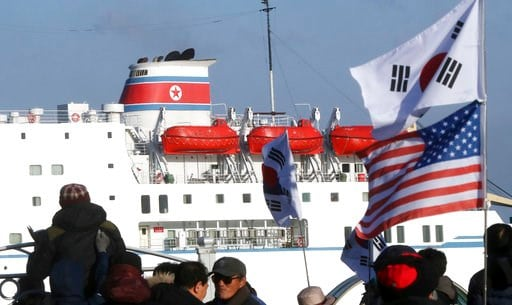 (Yang Yong-suck/Yonhap via AP). Members of conservative civic groups stage a protest against North Korea as North Korea's Mangyongbong-92 ferry, carrying North Korea's members of art troupe approaches to Mukho Port in Donghae, South Korea, Tuesday, Feb...