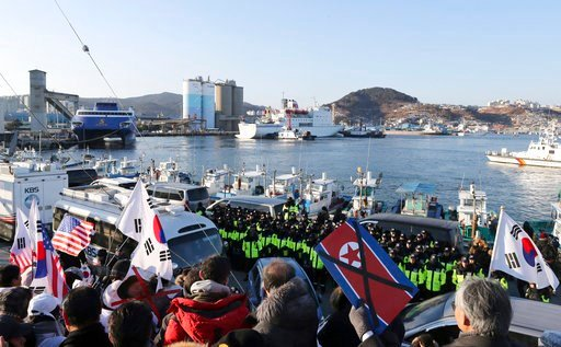 (Yang Yong-suck/Yonhap via AP). Members of conservative civic groups stage a protest against North Korea as North Korea's Mangyongbong-92 ferry, top center, carrying North Korea's members of art troupe approaching to Mukho Port in Donghae, South Korea,...