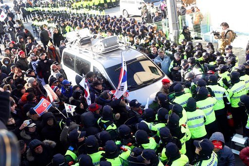 (Choo Sang-chul/Newisvia AP). Members of conservative civic groups scuffle with the police officers during a protest against North Korea as North Korea's Mangyongbong-92 ferry, carrying North Korea's members of art troupe approaching to Mukho Port in D...