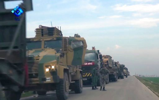 (Thiqa News via AP). This frame grab from video provided by the Thiqa News Agency, shows a Turkish military convoy near Tel al-Eiss in the province of Aleppo, Syria, Monday, Feb. 5, 2018. Turkey's state-run Anadolu Agency says a Turkish military convoy...