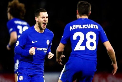 (AP Photo/Frank Augstein). Chelsea's Eden Hazard, left, celebrates with teammate Cesar Azpilicueta after scoring his side's first goal during the English Premier League soccer match between Watford and Chelsea at Vicarage Road stadium in London, Monday...