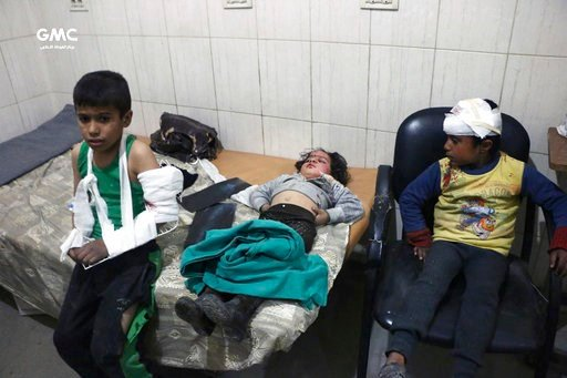 (Ghouta Media Center via AP). This photo provided by the Syrian anti-government activist group, Ghouta Media Center, GMC, which has been authenticated based on its contents and other AP reporting, shows children receiving treatment at a hospital in Haz...