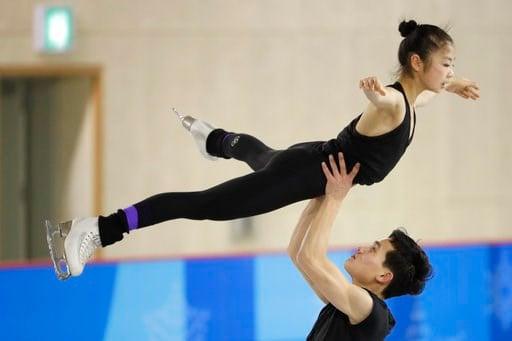 (AP Photo/Felipe Dana). North Korea's Ryom Tae Ok, top, and Kim Ju Sik, perform during a Pairs Figure Skating training session prior to the 2018 Winter Olympics in Gangneung, South Korea, Saturday, Feb. 3, 2018.