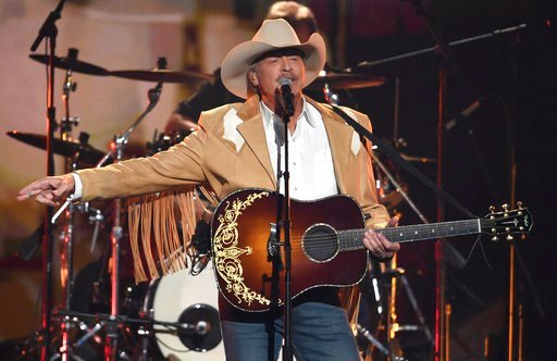 """(Photo by Chris Pizzello/Invision/AP, File). FILE - In this Wednesday, Nov. 8, 2017, file photo, Alan Jackson performs """"Chasin' That Neon Rainbow"""" at the 51st annual CMA Awards at the Bridgestone Arena in Nashville, Tenn. The 2018 Songwriters Hall of F..."""