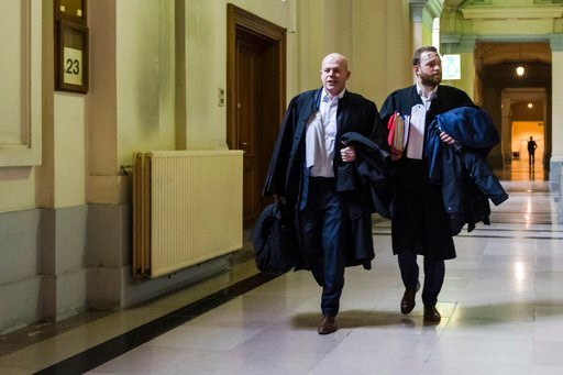 (AP Photo/Geert Vanden Wijngaert). Belgian lawyer Sven Mary, left, arrives for the trial of Salah Abdeslam at the Brussels Justice Palace in Brussels on Monday, Feb. 5, 2018. Salah Abdeslam and Soufiane Ayari face trial for taking part in a shooting in...