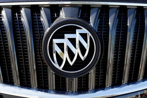 (AP Photo/Mark Humphrey). In this April 25, 2017, photo, a Buick Regal sits in a General Motors dealer's lot in Nashville, Tenn. General Motors Co. reports earnings, Tuesday, Feb. 6, 2018.