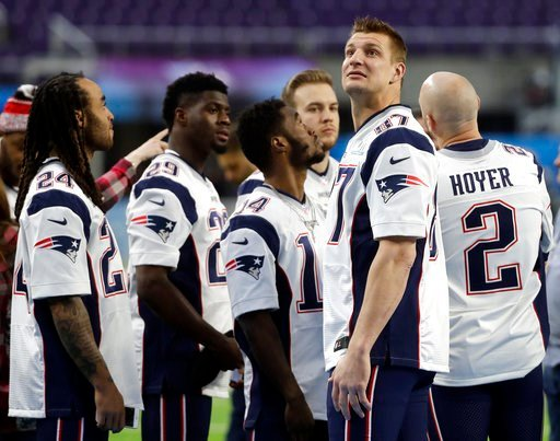(AP Photo/Mark Humphrey). New England Patriots tight end Rob Gronkowski (87) looks around U.S. Bank Stadium before the team photo is made Saturday, Feb. 3, 2018, in Minneapolis.
