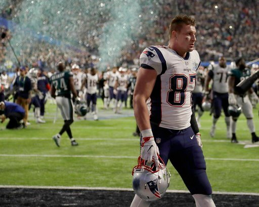 (AP Photo/Chris O'Meara). New England Patriots' Rob Gronkowski walks off the field after the NFL Super Bowl 52 football game against the Philadelphia Eagles Sunday, Feb. 4, 2018, in Minneapolis. The Eagles won 41-33.