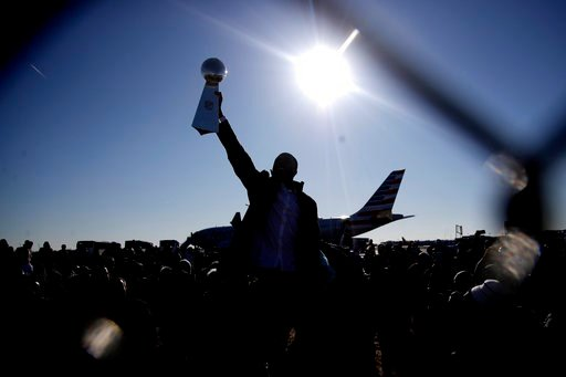 (AP Photo/Julio Cortez). Philadelphia Eagles wide receiver Nelson Agholor holds up the Vince Lombardi Trophy while displaying it to fans gathered to welcome them in Philadelphia, Monday, Feb. 5, 2018, a day after defeating the New England Patriots in S...