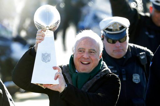 (AP Photo/Julio Cortez). Philadelphia Eagles owner Jeffrey Lurie carries the Vince Lombardi Trophy while walking to a fence to show it to fans gathered to welcome them in Philadelphia a day after defeating the New England Patriots in Super Bowl 52, Mon...