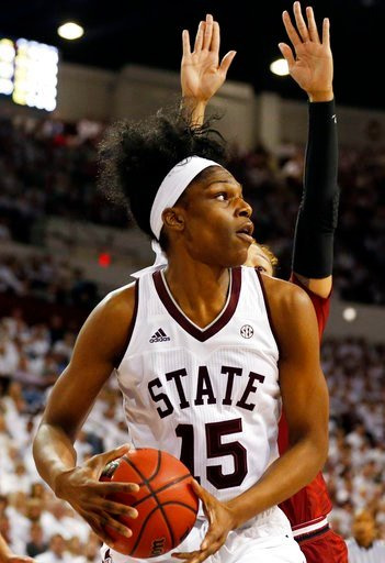 (AP Photo/Rogelio V. Solis). Mississippi State center Teaira McCowan (15) looks for a open teammate to pass to as she is being defended by a South Carolina player behind her, during the first half of the NCAA college basketball game in Starkville, Miss...