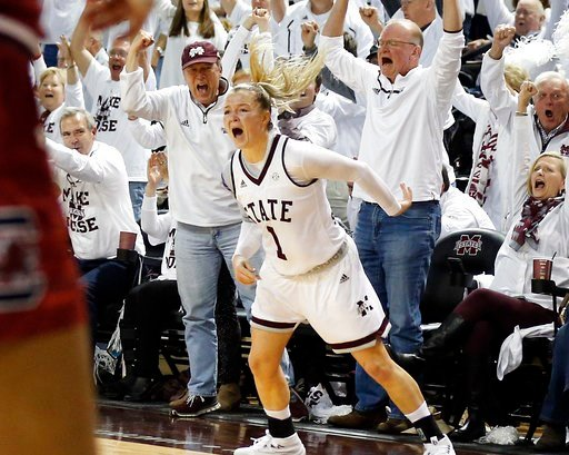 (AP Photo/Rogelio V. Solis). Mississippi State guard Blair Schaefer (1) and the fans react to her three-point basket during the second half of the NCAA college basketball game against South Carolina in Starkville, Miss., Monday, Feb. 5, 2018. Mississip...