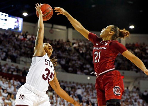 (AP Photo/Rogelio V. Solis). Mississippi State guard Victoria Vivians (35) has a shot rejected by South Carolina forward Mikiah Herbert Harrigan (21) during the first half of the NCAA college basketball game in Starkville, Miss., Monday, Feb. 5, 2018.