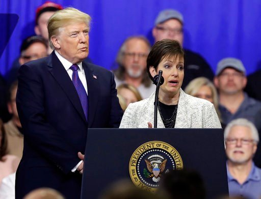 (AP Photo/Evan Vucci). Deana Spoleti speaks as President Donald Trump listens during a speech on tax policy during a visit to Sheffer Corporation, Monday, Feb. 5, 2018, in Blue Ash, Ohio.