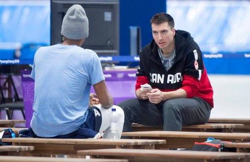 (Paul Chiasson/The Canadian Press via AP). Canada's Alex Boivert-Lacroix chats with Shani Davis of the Unites States following a speed skating practice Monday, Feb. 5, 2018 in Gangneung.
