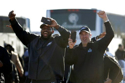 (AP Photo/Julio Cortez). Philadelphia Eagles defensive tackle Fletcher Cox, left, and head coach Doug Pederson approach a fence where fans gathered to welcome the team Monday, Feb. 5, 2018, at Philadelphia International Airport a day after defeating th...