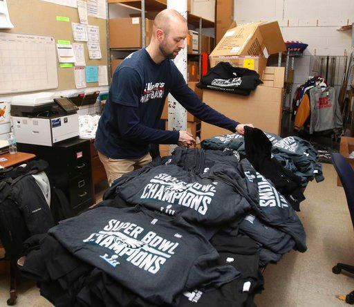 (Dave Scherbenco/The Citizens' Voice via AP). Staffer Matt Camella, of Schuylkill Valley Sports, sorts a shipment of newly arrived Philadelphia Eagles Super Bowl championship shirts at their Wyoming Valley Mall location, Monday, Feb. 5, 2018, in Wilkes...