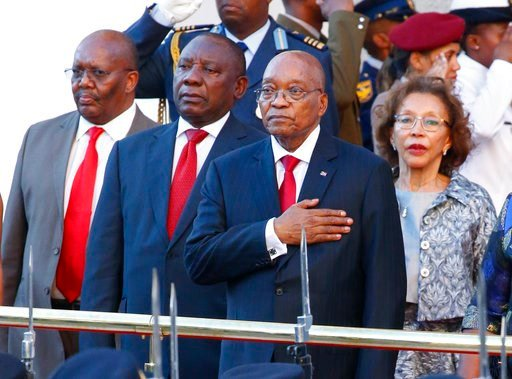 (AP Photo/Nic Bothma, Pool). FILE - In this Thursday, Feb. 9, 2017 file photo, South African President Jacob Zuma, front, gestures on his arrival at parliament in Cape Town, South Africa, for his State of the Nation address. The president has been enme...