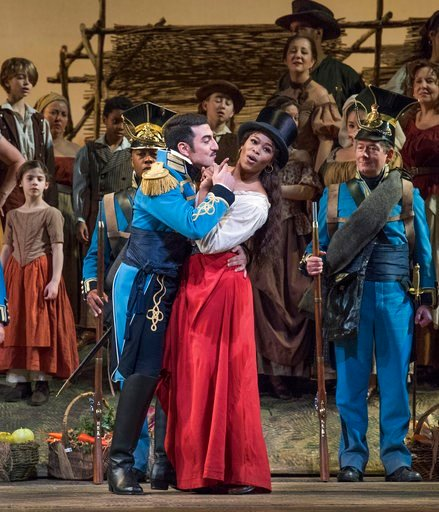 """(Metropolitan Opera via AP). This Jan. 12, 2018 photo released by the Metropolitan Opera shows a performance of Donizetti's """"L'Elisir d'Amore"""" (""""The Elixir of Love"""") which will be broadcast to movie theaters worldwide on Saturday, Feb. 10, as part of t..."""