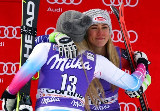 (AP Photo/Alessandro Trovati, File). FILE - In this Friday, Jan. 19, 2018 file photo, United States' Mikaela Shiffrin, third place in an alpine ski, women's World Cup downhill, right, is hugged by second-placed United States' Lindsey Vonn, in Cortina D...