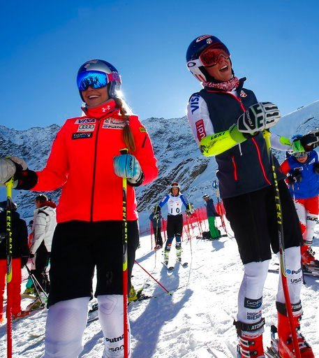 (AP Photo/Giovanni Auletta, File). FILE - In this Friday, Oct. 23, 2015 file photo, Lindsey Vonn, of the United States, left, and teammate Mikaela Shiffrin stand at the finish area at the Rettenbach glacier, ahead of Saturday's women's giant slalom Ski...