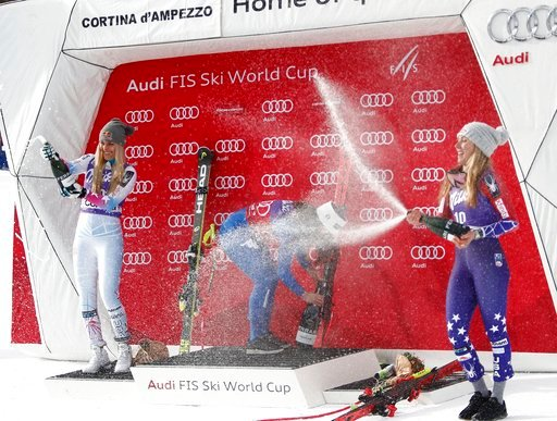 (AP Photo/Alessandro Trovati, File). FILE - In this Friday, Jan.19, 2018 file photo, Italy's Sofia Goggia, center, winner of an alpine ski, women's World Cup downhill, celebrates on the podium with second-placed United States' Lindsey Vonn, left, and t...