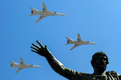 (AP Photo/Pavel Golovkin, File). FILE - In this Monday, May 9, 2016 file photo, Russian Tu-22M-3 long-range bombers fly during the Victory Day military parade marking 71 years after the victory in WWII in Red Square in Moscow, Russia. Russia says it ha...