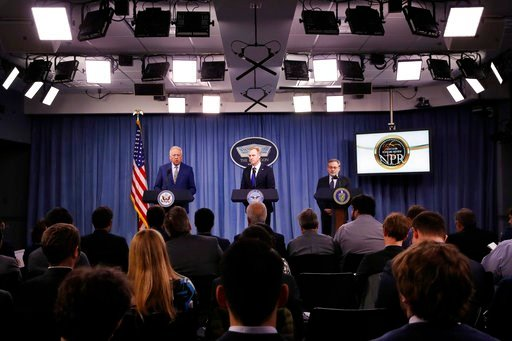 (AP Photo/Jacquelyn Martin). FILE - In this Feb. 2, 2018, photo, Under Secretary of State for Political Affairs Thomas Shannon, left, Deputy Defense Secretary Patrick Shanahan, and Deputy Energy Secretary Dan Brouillette, lead a news conference on the ...