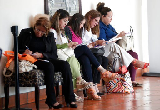 (AP Photo/Lynne Sladky). In this Tuesday, Jan. 30, 2018, photo, women fill out job applications at a JobNewsUSA job fair in Miami Lakes, Fla. The Labor Department reports on job openings and labor turnover for December, on Tuesday, Feb. 6.