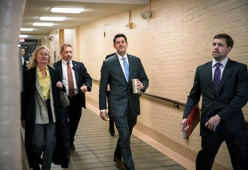 (AP Photo/J. Scott Applewhite). House Speaker Paul Ryan, R-Wis., center, walks to a Republican strategy conference at the Capitol as House GOP leaders are proposing to keep the government open for another six weeks by adding a year's worth of Pentagon ...