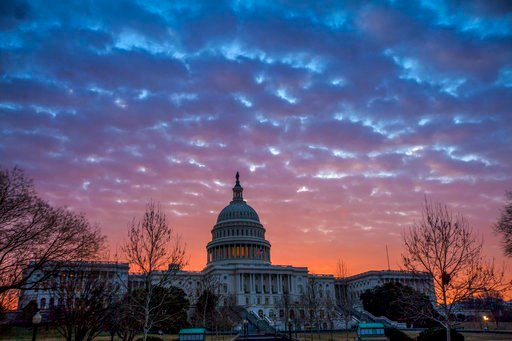 (AP Photo/J. Scott Applewhite). Dawn breaks over the Capitol in Washington, Tuesday, Feb. 6, 2018, as House GOP leaders are proposing to keep the government open for another six weeks by adding a year's worth of Pentagon funding to a stopgap spending b...