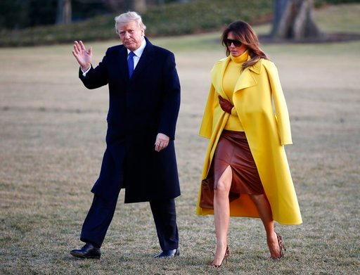 (AP Photo/Carolyn Kaster). President Donald Trump and first lady Melania Trump walk from Marine One to the White House in Washington, Monday, Feb. 5, 2018, as they return from Ohio.