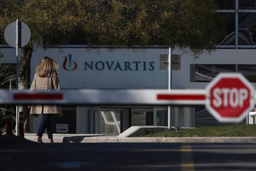(AP Photo/Petros Giannakouris). A woman enters Novartis Greek offices in Athens, on Tuesday, Feb. 6, 2018. Greece's government says it has evidence that senior politicians from the previous administration were involved in a bribery case in which Swiss ...