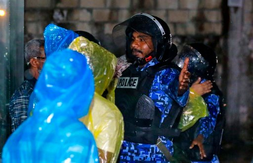 (AP Photo/Mohamed Sharuhaan). Maldives policemen clear the area of supreme court after the government declared a 15-day state of emergency in Male, Maldives, early Tuesday, Feb. 6, 2018. The Maldives government declared a 15-day state of emergency Mond...