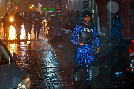 (AP Photo/Mohamed Sharuhaan). A Maldives policeman charges with baton towards protesters after the government declared a 15-day state of emergency in Male, Maldives, early Tuesday, Feb. 6, 2018. The Maldives government declared a 15-day state of emerge...