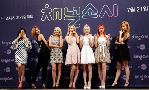 "(AP Photo/Lee Jin-man, File). FILE - In this July 21, 2015 file photo, South Korean girl group Girls' Generation pose for the media during a presentation to promote their new reality TV program ""Channel Girls' Generation"" in Seoul, South Korea. The clo..."