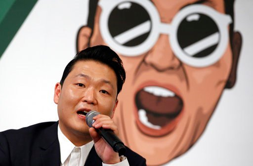 (AP Photo/Lee Jin-man, File). FILE - In this Nov. 30, 2015 file photo, South Korean singer PSY answers a reporter's question during a news conference on the release of his seventh album in Seoul, South Korea.  The clothes, the hair, the confidence , th...