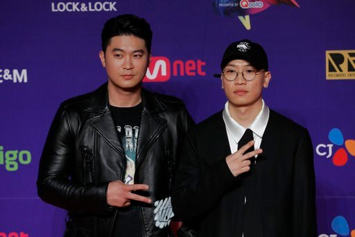 (AP Photo/Kin Cheung, File). FILE - In this Dec. 1, 2017 file photo, members of South Korean music band Dynamic Duo pose for photos on the red carpet of the Mnet Asian Music Awards (MAMA) in Hong Kong.  The clothes, the hair, the confidence , the look ...