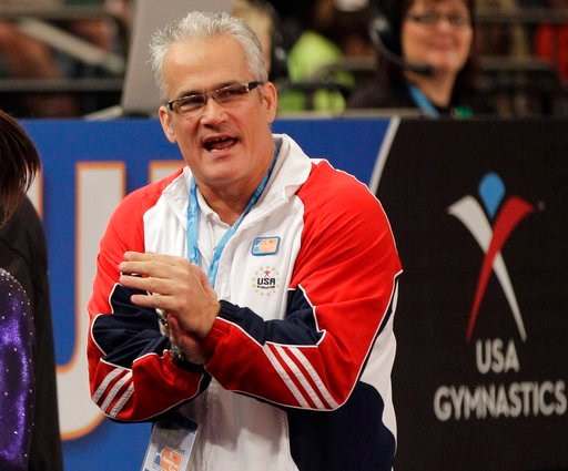 (AP Photo/Kathy Willens, File). FILE - In this March 3, 2012, file photo, gymnastics coach John Geddert is seen at the American Cup gymnastics meet at Madison Square Garden in New York. Geddert, a former U.S. women's gymnastics national team coach, is ...