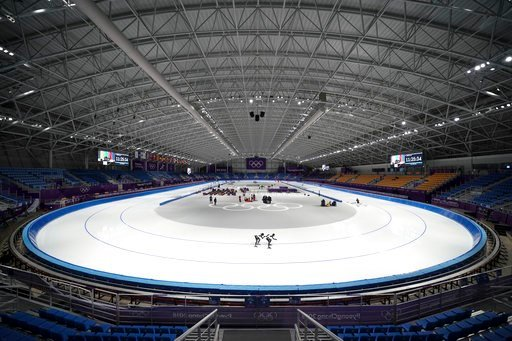 (AP Photo/Felipe Dana, File). FILE- In this Tuesday, Feb. 6, 2018, file photo, athletes from Japan practice at the Gangneung Oval during a speed skating training session prior to the 2018 Winter Olympics in Gangneung, South Korea. As with past Olympics...