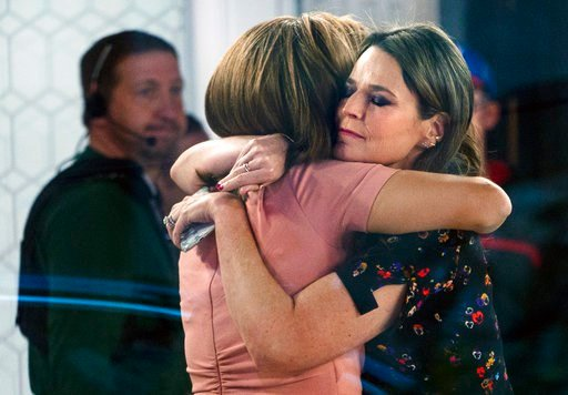 "(AP Photo/Craig Ruttle, File). FILE - In this Nov. 29, 2017 file photo, co-anchors Hoda Kotb, left, and Savannah Guthrie embrace on the set of the ""Today"" show in New York after NBC News fired host Matt Lauer for ""inappropriate sexual behavior."" Kotb b..."